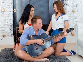 Two sporty babes seduce musician